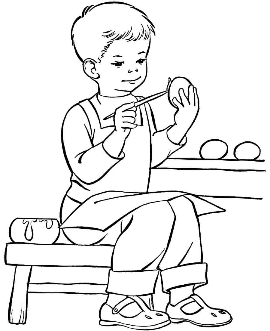 Раскраска Мальчик красит пасхальные яйца