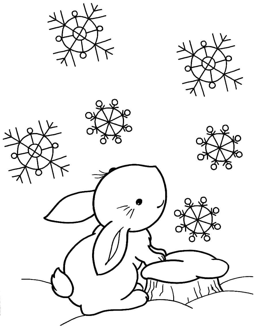 Раскраска Зайчик наслаждается зимой